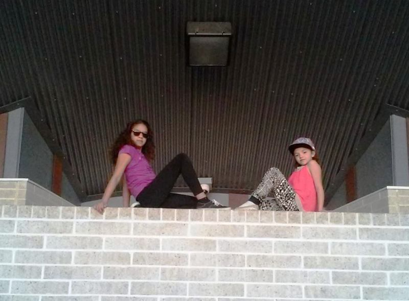 Natalia and Sarah on wall
