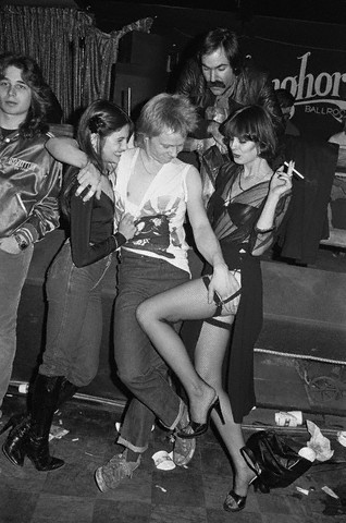 1978: Paul Cook of The Sex Pistols with Two Women. Image by © Lynn Goldsmith/Corbis. (Image found on The Selvedge Yard.)